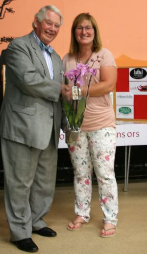 Lynda Scott, Membership Secretary Presenting a token of appreciation to Lord Naseby
